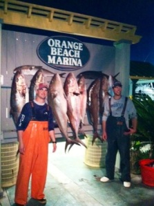 Charter Boat Intimidator crew members Barry Bracknell and Drew Phillips show off a great catch of winter time Amberjack